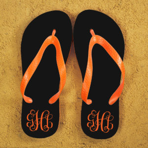 Monogrammed Flip Flops in Black and Orange
